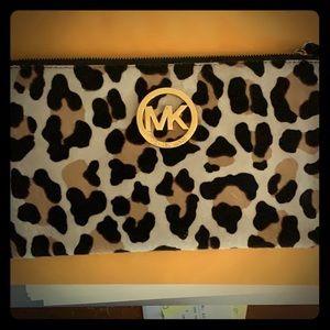 Preowned Authentic Michael Kors leopard wristlet